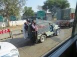 Men on back of jeep