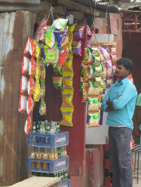 Small street-side shop selling chips and sweets. There are hundreds of these in Kathmandu